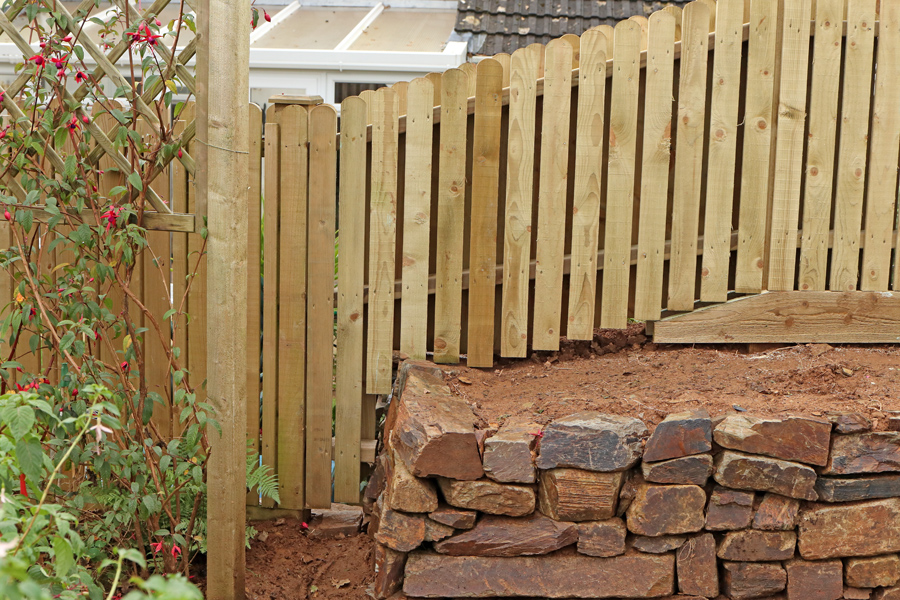 Joining on to the existing fence which stopped at the capped post.
